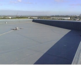 Finished flat roof for a warehouse