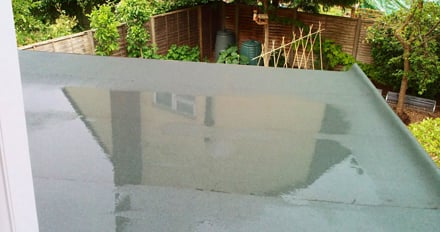 water pooling on flat roof